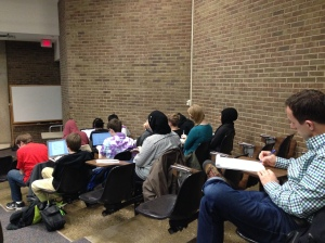 Students and instructors actively taking notes during the lecture.